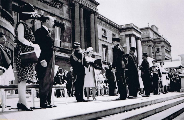 Her Majesty presenting the Royal Pipe Banners for both Battalions at Buckingham Palace 27 June 1962. Field Marshal Lord Harding can be seen on the right beyond the second Pipe Major.